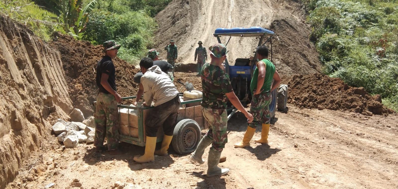 TNI Membantu Pemda Dalam Pembangunan di Wilayah Pakpak BharatTNI Membantu Pemda Dalam Pembangunan di Wilayah Pakpak Bharat